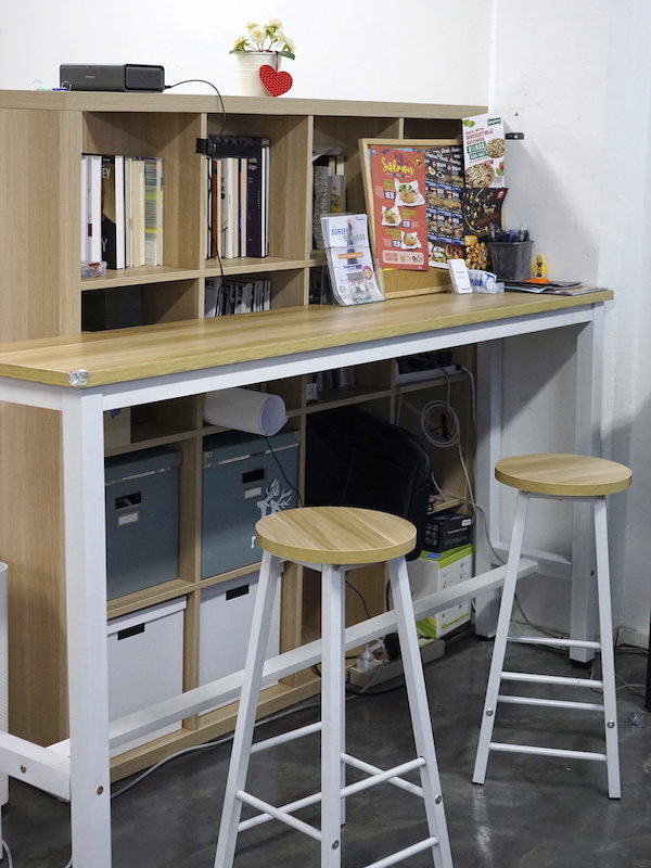 take-a-look-inside-our-new-laid-back-office-book-shleve-standing